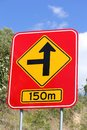 Concealed road warning side m an australian roadside sign of hidden meters ahead Stock Images