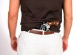 Concealed weapon man with revolver has the behind his back in his pants Royalty Free Stock Photography