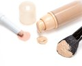 Concealer pencil and foundation with makeup brush Royalty Free Stock Photo