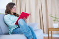 Concentrate brunette reading a book Royalty Free Stock Photo