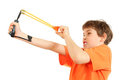 Concentrated boy with slingshot aim Royalty Free Stock Photos