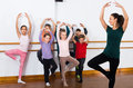 Concentrated boys and girls rehearsing ballet dance in studio Royalty Free Stock Photo