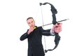 Concentrated businessman shooting a bow and arrow Royalty Free Stock Photo