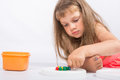 Concentrated girl collects mosaic five year Stock Photography