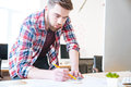 Concentrated handsome man working and drawing blueprint Royalty Free Stock Photo
