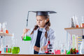 Concentrated little girl posing in chemistry lab close up Royalty Free Stock Photography