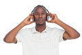 Concentrated man listening to music on a white background Royalty Free Stock Photo