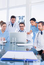 Concentrated medical team using laptop together in the office Stock Photos