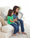 Concentrated mom and daughter playing video games Stock Photography