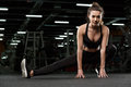 Concentrated strong fitness lady make stretching exercise Royalty Free Stock Photo