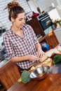 Concentrated woman standing and cooking on the kitchen Royalty Free Stock Photo