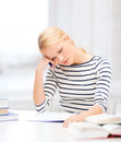 Concentrated woman studying in college education school and business concept with books and notebook Stock Image