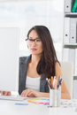 Concentrated woman using computer in office young a bright Royalty Free Stock Image
