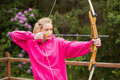 Concentrating blonde practicing archery Royalty Free Stock Photo