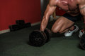 Concentrating for a deadlift bodybuilder is standing and preparing with dumbbells Royalty Free Stock Photos