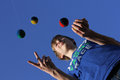 Concentration juggling balls pupil is with five success in school with Royalty Free Stock Photography