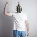 Concept of angry man creative portrait grenade head pulling the pin Stock Photos