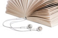 Concept of audio books with earphones on white Stock Photo
