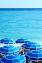 Concept of beach holiday image summer vacation on the showing parasols on tropical Royalty Free Stock Photo