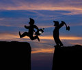 Concept cartoon silhouette, Man hold axe and  Man jumping Royalty Free Stock Photo