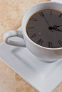 Concept coffee time closeup cup coffee clock faded Stock Photos
