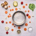 Concept cooking vegetable soup with carrots and spinach, vintage pan around which laid out ingredients and seasonings place fo Royalty Free Stock Photo