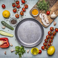 Concept cooking vegetarian food ingredients laid out around the pan with spices, mushrooms, butter wooden rustic background top Royalty Free Stock Photo