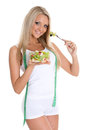 Concept of dieting slender young woman with tape measure holds a bowl salad on a white background Stock Photography