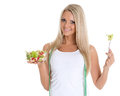 Concept of dieting slender young woman with tape measure holds a bowl salad on a white background Stock Photos