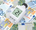 Concept of energy saving one digital thermostatic valve over euro banknotes d render Stock Photos