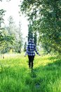The concept of enjoying nature. Girl in a hooded shirt Royalty Free Stock Photo
