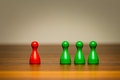 Concept good bad isolation confrontation competition for or and difference with colorful red and green pawn figures on wooden Royalty Free Stock Images