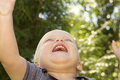 Concept of happiness .Close up portrait of smiling happy baby boy. Bottom view Royalty Free Stock Photo
