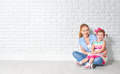Concept happy family mother and baby daughter,  girl at blank br Royalty Free Stock Photo