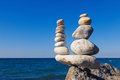 Concept of harmony and balance. Rock Zen on the background of summer sea. Royalty Free Stock Photo
