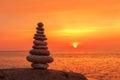 Concept of harmony and balance. Rock Zen on sunset background. Royalty Free Stock Photo