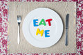 Concept healthy food and diet eat me message on a white plate Royalty Free Stock Photo