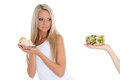 Concept of healthy food young beautiful woman choosing between bowl salad with fresh vegetables and piece cake on a white Stock Photo
