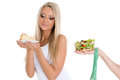 Concept of healthy food young beautiful woman choosing between bowl salad with fresh vegetables and piece cake on a white Royalty Free Stock Image