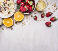 The concept of a healthy and wholesome breakfast cereal with nuts and fruit place for text frame wooden rustic background top on Royalty Free Stock Photo