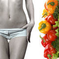 Concept image of healthy food and a female belly Royalty Free Stock Photo