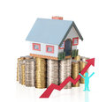 Concept by money house from coins mortgage Royalty Free Stock Image