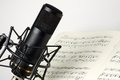 Studio microphone with music sheet Royalty Free Stock Photo