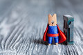 Concept number one clothespin superhero and one written with colored vintage letterpress gray background confident Stock Images