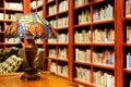 old library study reading room table lamp desk light books bookshelf Royalty Free Stock Photo