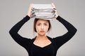 Concept for overworking woman with folders tired young business a big pile of Stock Images