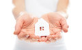 Concept paper figurine house in hands the Stock Images