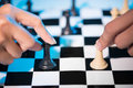 Concept of partnership close up two people playing chess Royalty Free Stock Photo