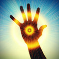Concept of power in hand conceptual image a which radiates rays light Stock Images