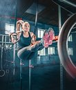 Concept: power, strength, healthy lifestyle, sport. Powerful attractive muscular woman at CrossFit gym Royalty Free Stock Photo